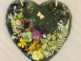 Slate heart with flowers and bumblebee